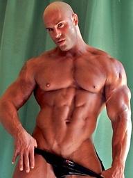 Bodybuilder Peter Latz flexes and poses