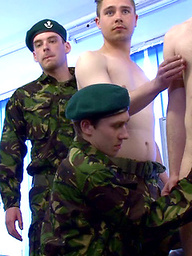 Embarrassed private gets his dick played with while everyone else is in uniform