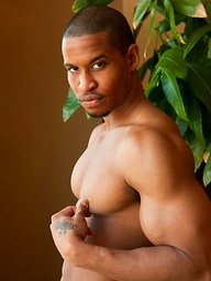 Jackson shows his muscled ebony body