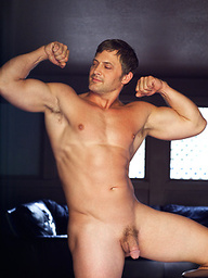 Muscle hunk shows his perfect body