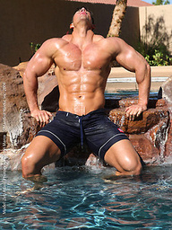 Zeb Atlas shows his massive body outdoors