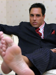 Horny Marcello wearing a pin stripe suit with bare feet and masturbating