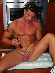 Latin hunk jerking off dick