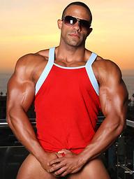 Muscled latino Rico posing on a balcony