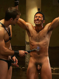 Phenix Saint shocks the hell out of Gianni Luca and fucks him hard in suspension bondage.
