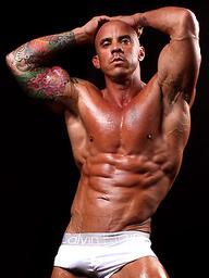 Bald bodybuilder Vin Marco shows his muscled boner