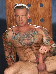 Mature muscle man Cory Jay shows his perfect tattooed body