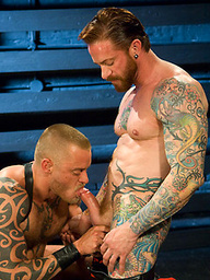 Red Nanky. Tattooed guys in gay fisting scene.