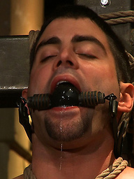 Josh West puts Justin Ryder in bondage and fucks Justin's hairy ass with his enormous cock.