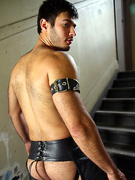 Alexander Morales enjoys wearing leather chaps on his hairy body, as it frames his ass and uncut cock