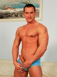 Hard bodied hottie Michael Troy takes his jeans off to show his swollen package