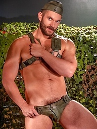 Beefy hunk Dolan Wolf is barely in uniform as he shows his throbbing boner