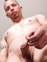 Straight, tatted guy  jerking off his uncut dick