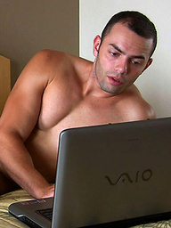 Short haired Latino Thiago watches porn and strokes himself until he cums