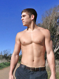 Hot young athlete Gregory shows his muscle body and strokes