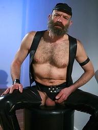 Daddy bear Dan Black in leather gear