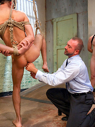 Two studs with monster cocks fuck and fist Kyler Rouge in bondage.