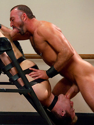 A sexy stud endures a brutal bondage workout including flogging, electro, and a hard suspension fuck from a sadistic trainer with an enormous cock.