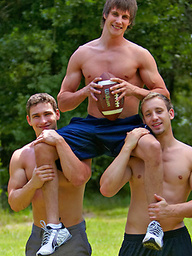 Three muscle studs fucking outdoors