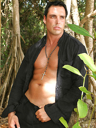 Marcello looking hot and sticky wanking by on a tropical beach