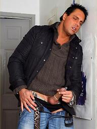 Horny Marcello masturbates his big cock inside a condom
