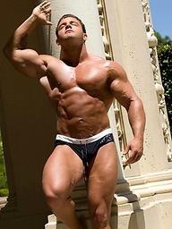 Bodybuilder posing outdoors