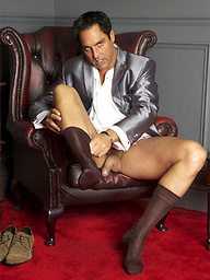 Well dressed Marcello pulls out that big cock of his and has some sock fun