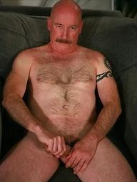 Bald daddy Dan Bennett jacking off dick