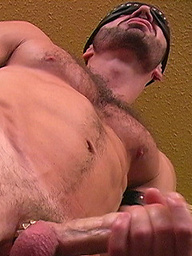 Muscle man Raven strokes dick